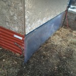 Polycarbonate panel on chicken coop for solar heat gain